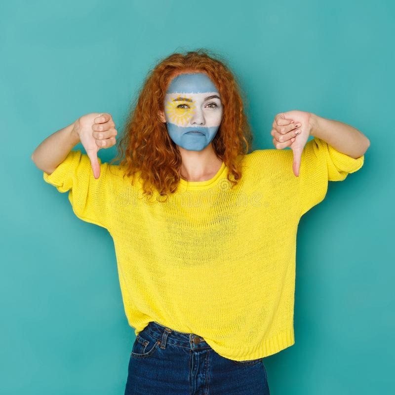 Young woman with Argentina flag painted on her face royalty free stock images