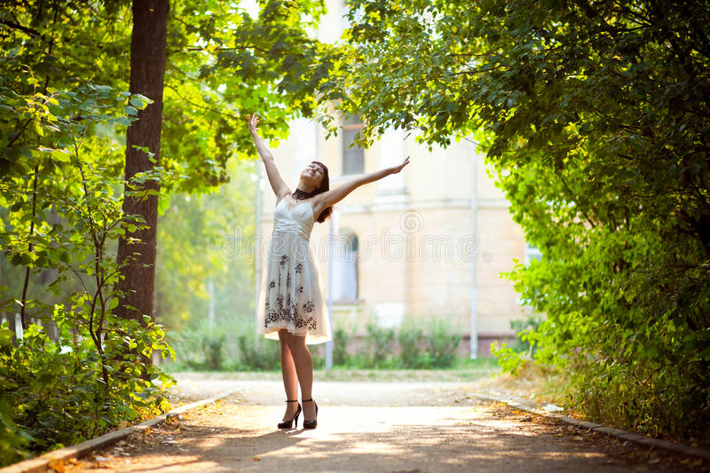 Download Young Woman Arms Raised Enjoying The Fresh Air In Stock Photo - Image: 15814472