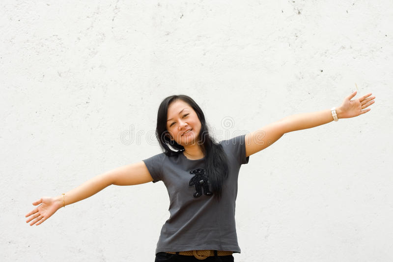Young Woman With Arms Wide Open Stock Photography