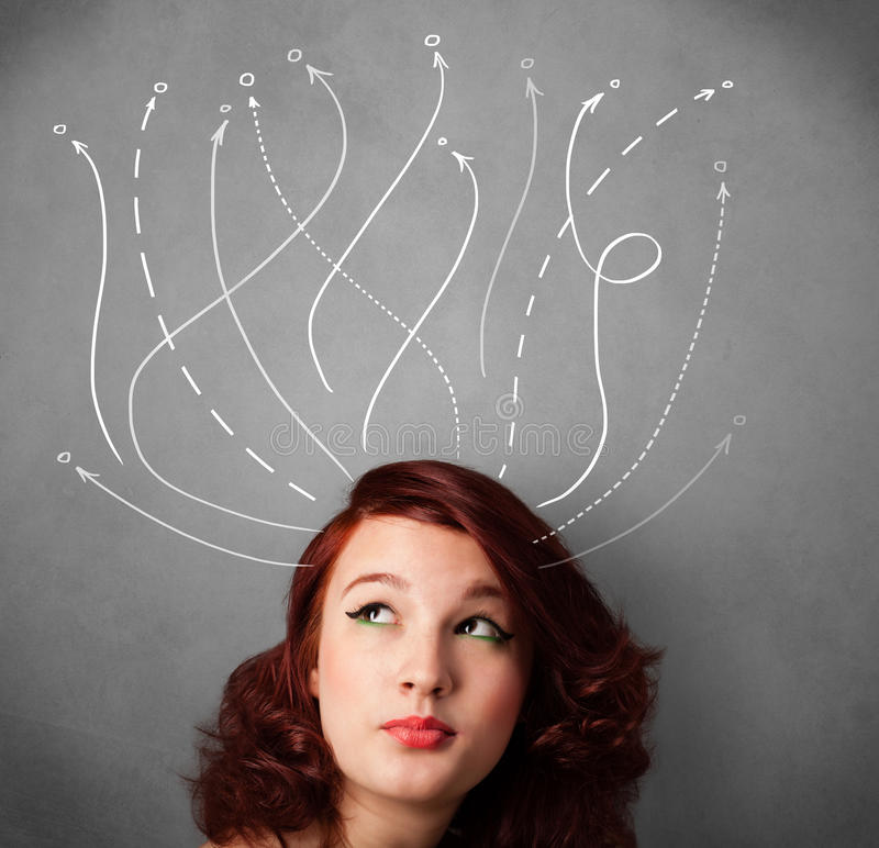 Young woman with arrows coming out of her head stock photos