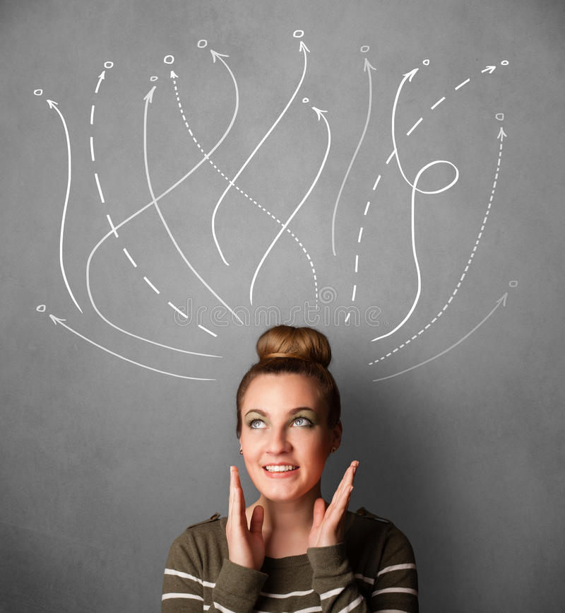 Young woman with arrows coming out of her head. Pretty young woman thinking with arrows in different directions above her head royalty free stock image
