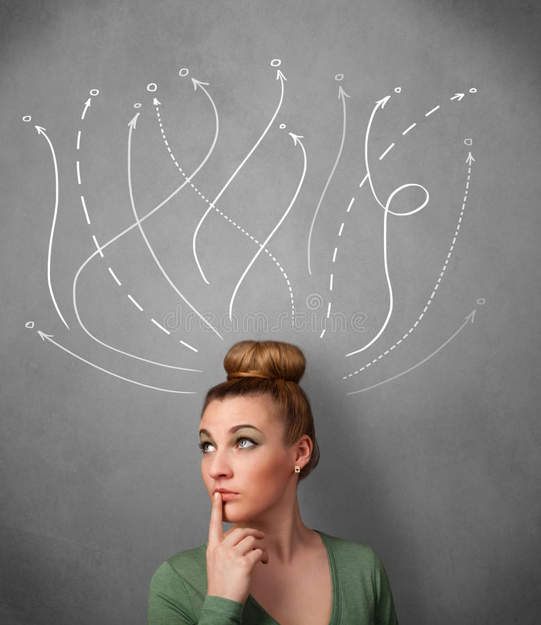 Young woman with arrows coming out of her head. Pretty young woman thinking with arrows in different directions above her head royalty free stock photo