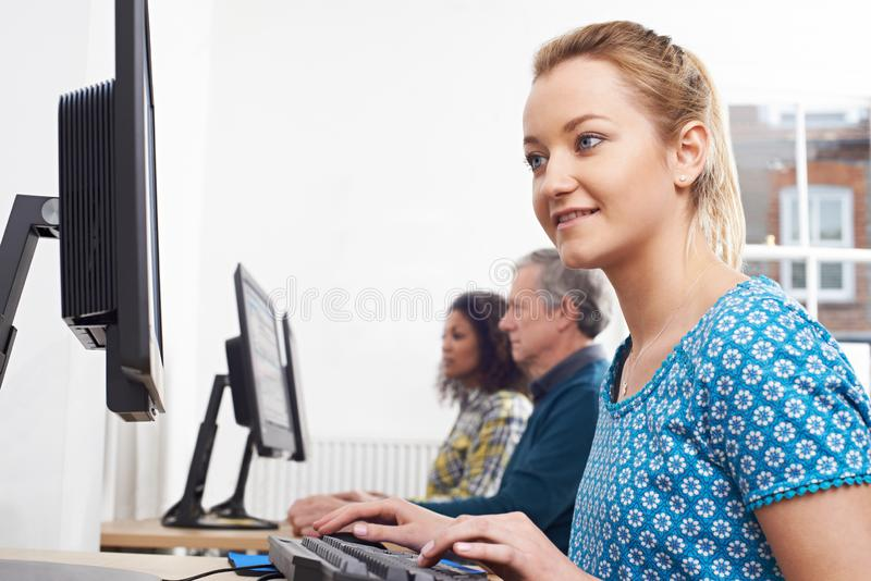 Young Woman Attending Computer Class In Front Of Screen royalty free stock photos