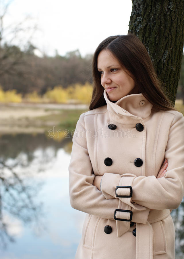 Young woman by the autumn lake stock photo