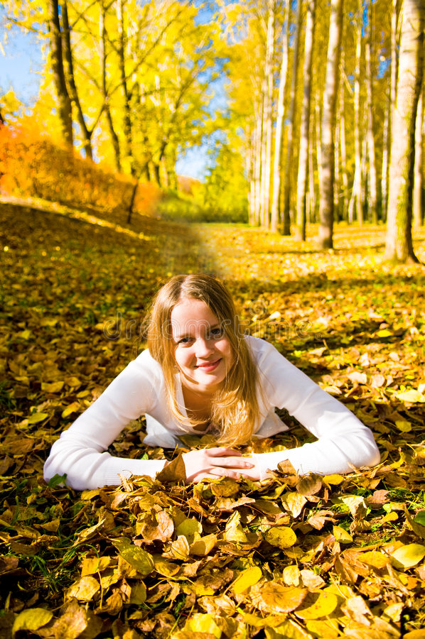 Download Young Woman On The Autumn Leaf Stock Photo - Image of color, freedom: 6807210
