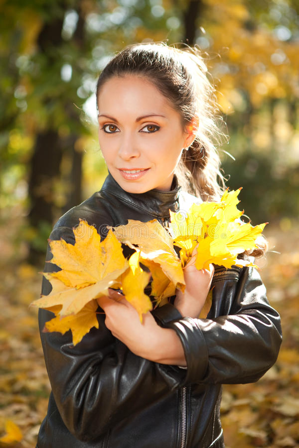 Young woman in the autumn park royalty free stock image