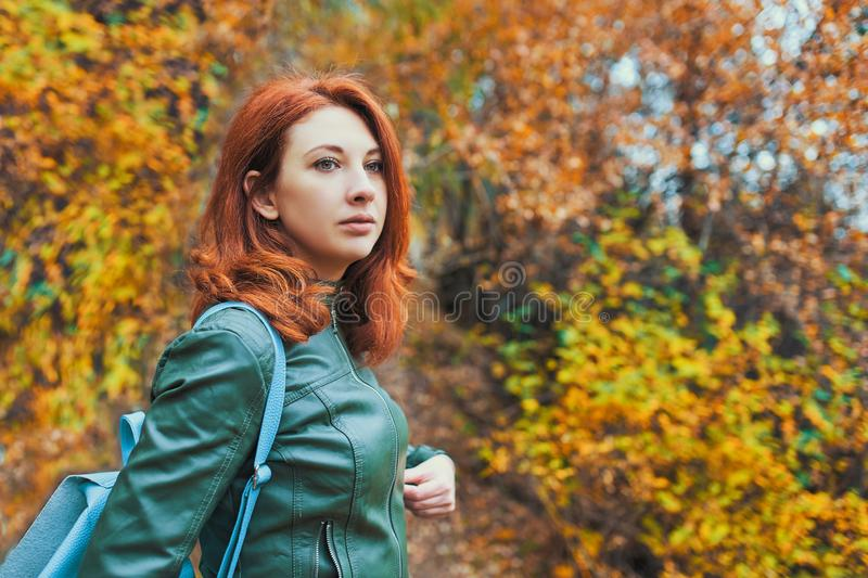 Young woman with autumn tree. royalty free stock photo
