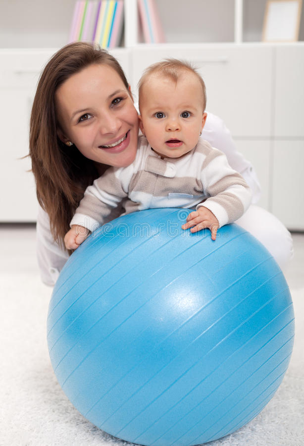Download Young woman and baby stock image. Image of helped, lifestyle - 23494311