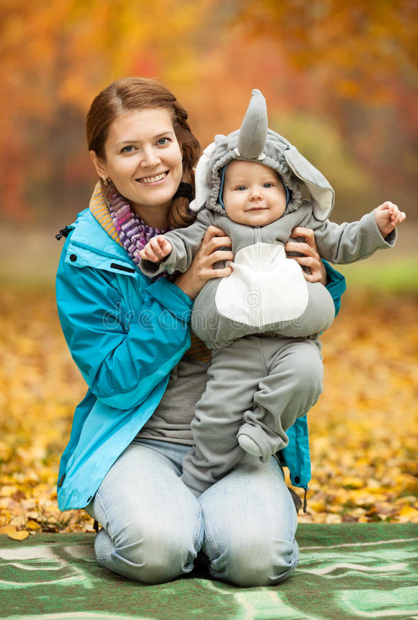 Young woman and baby dressed in elephant costume stock images