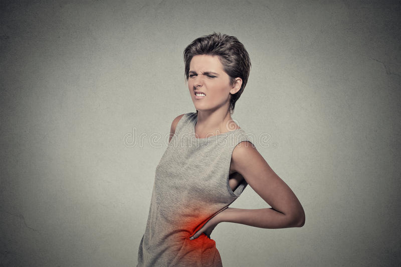 Young woman with backache back pain back colored in red stock photos
