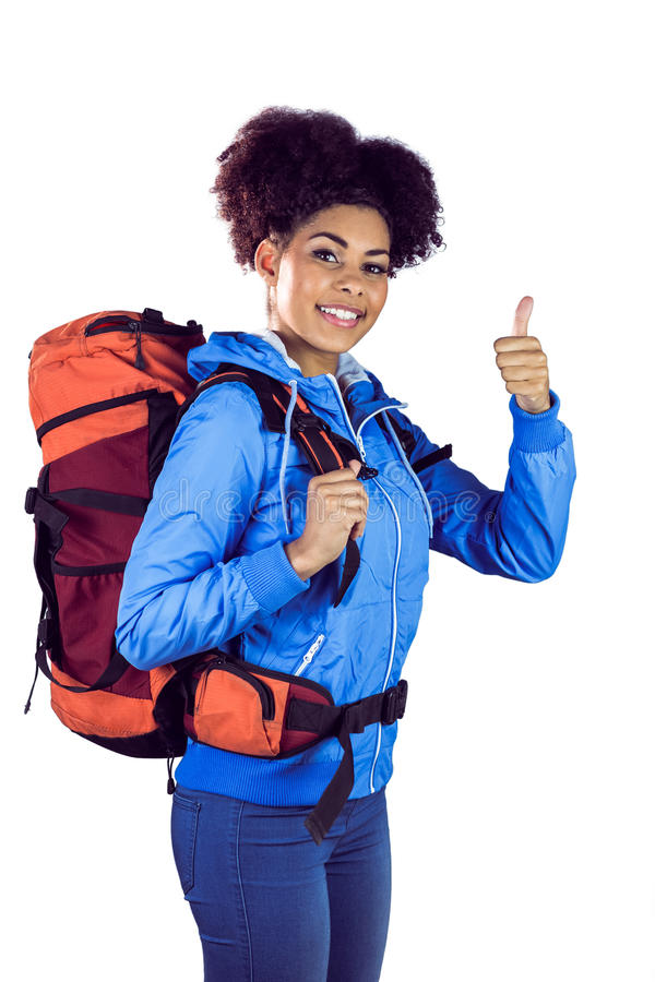 Young woman with backpack hitchhiking. Against a white background royalty free stock photos