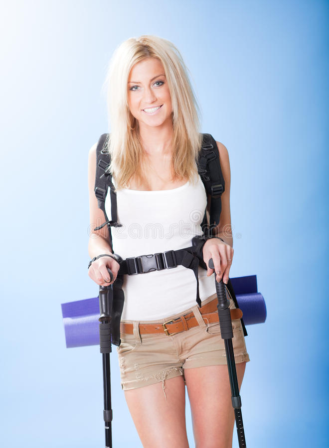 Download Young Woman With Backpack And Jogging Sticks Stock Photo - Image: 23546082