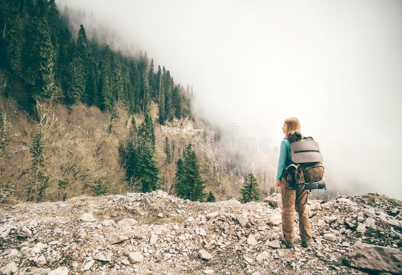 Young Woman with backpack relaxing outdoor royalty free stock photography