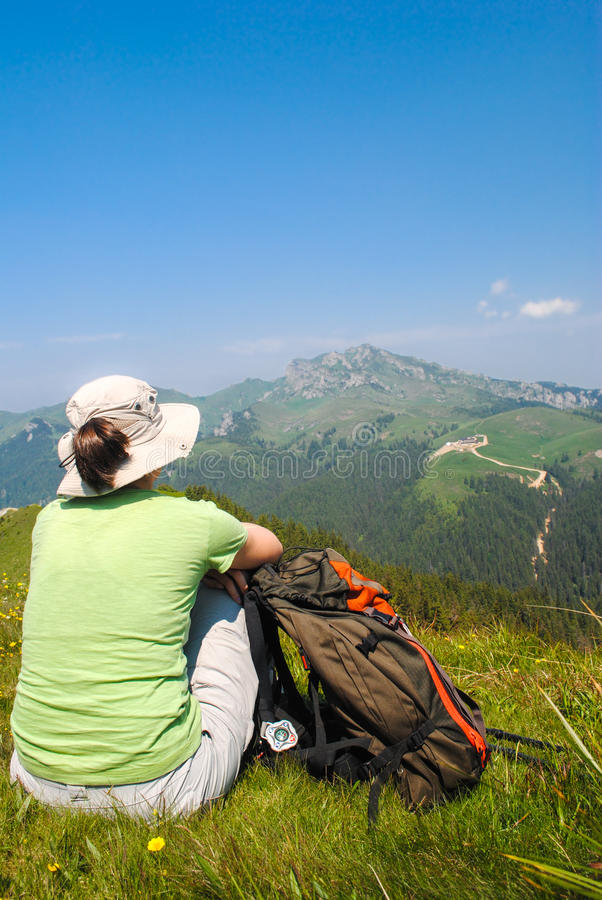 Young woman with backpack stock image