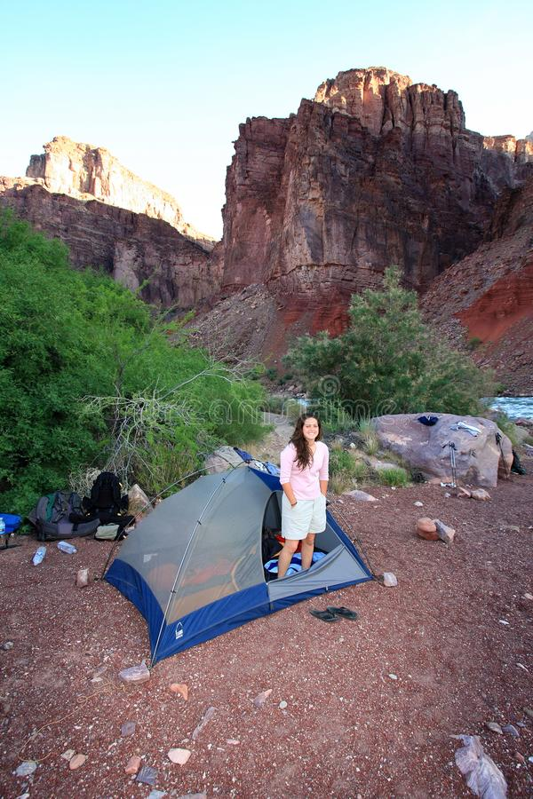 Young woman backpacker in tent in the Grand Canyon. Young woman backpacker in her tent at the Hance Rapids campsite in Grand Canyon National Park, Arizona stock photos