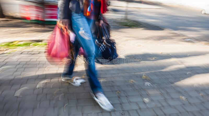 Young woman on the road in the city royalty free stock photography