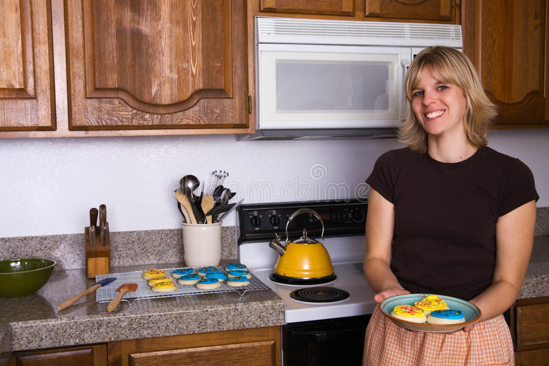 Young Woman With Baked Cookies royalty free stock image