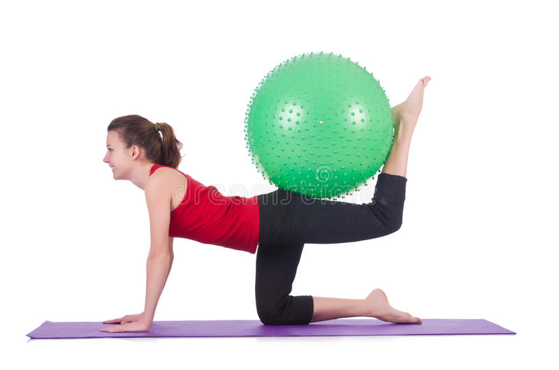 Young Woman With Ball Exercising Stock Images