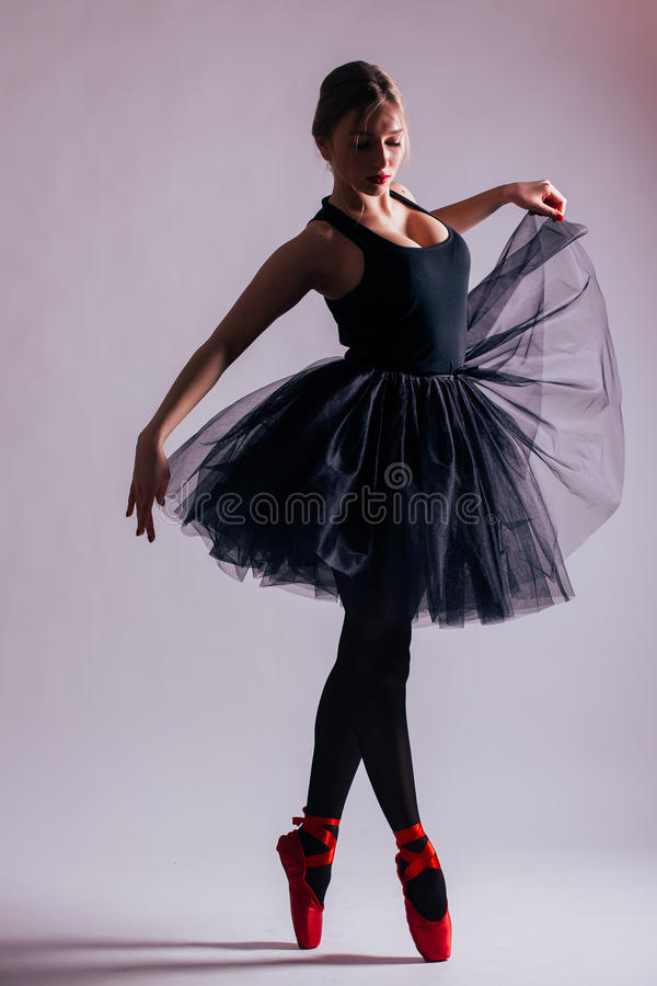 Young woman ballerina ballet dancer dancing with tutu in silhouette royalty free stock image