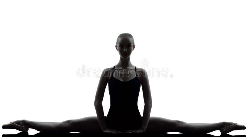 Young woman ballerina ballet dancer stretching war stock photos