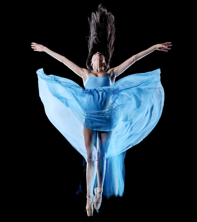 Young woman ballet dancer dancing isolated black background light painting royalty free stock photo