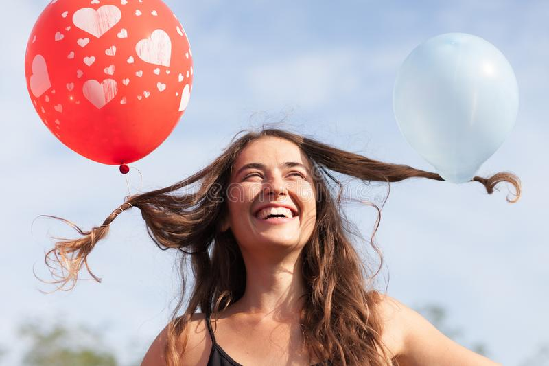Young woman with balloons in her hair royalty free stock photos