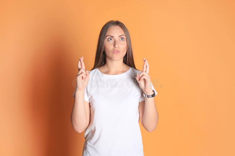 Young woman in basic clothing throws dab on yellow background. Young woman in basic clothing throws dab on yellow background royalty free stock photo