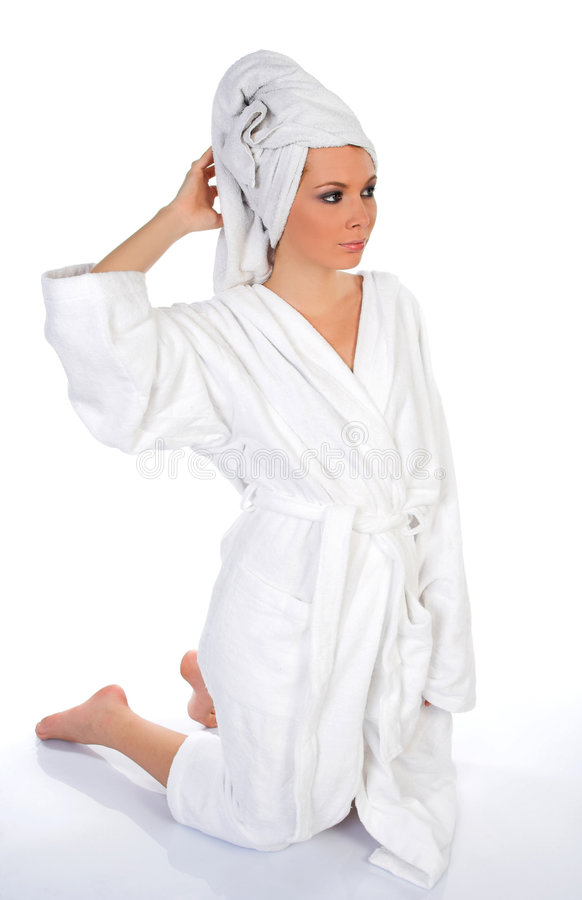 Young woman in bathrobe stock image