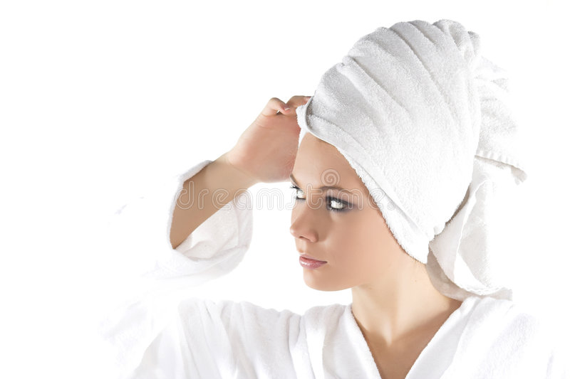 Young woman in bathrobe stock photo