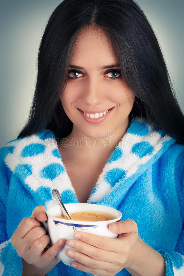 Young Woman in Bathrobe Holding a Big Cup of Coffee stock photography