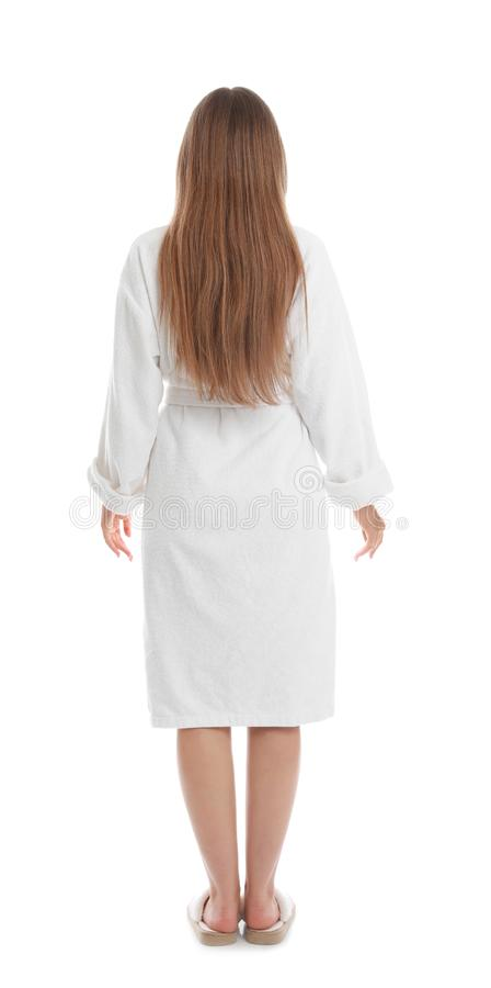 Young woman in bathrobe on background royalty free stock photo