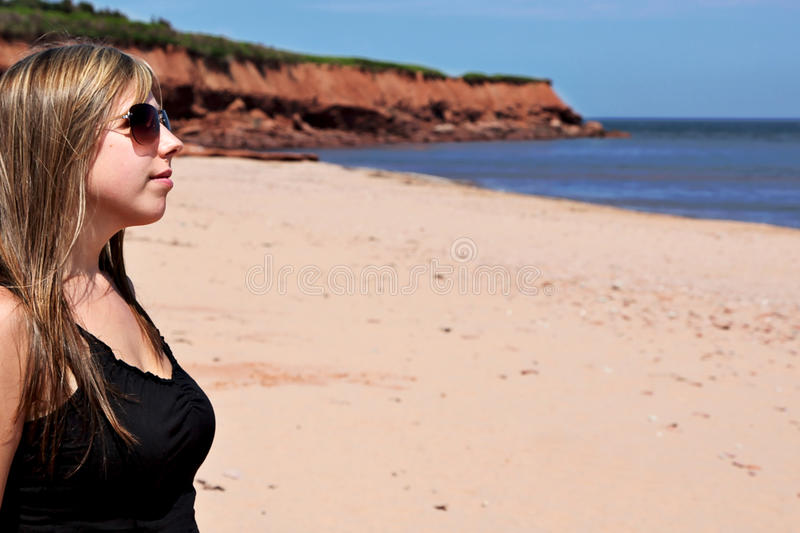 Young Woman on Beach royalty free stock images
