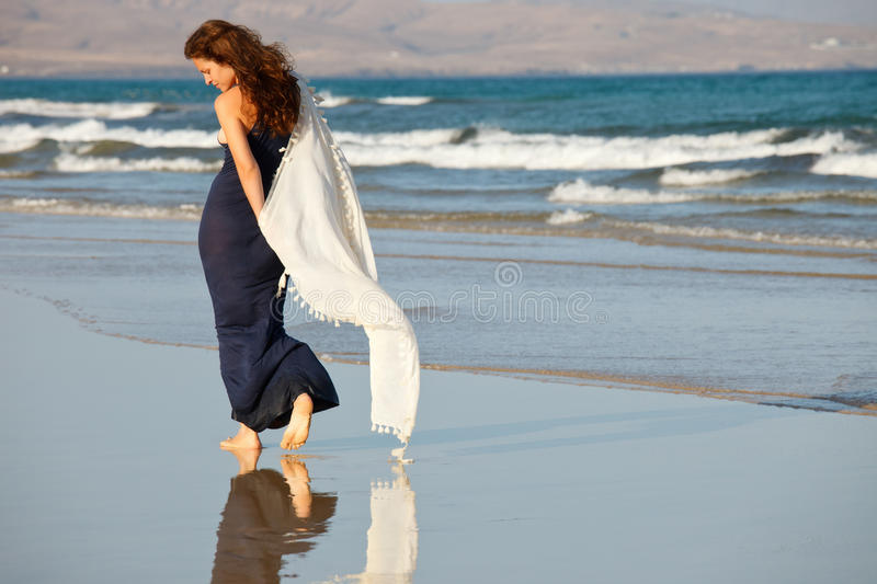 Young woman on a beach royalty free stock photography