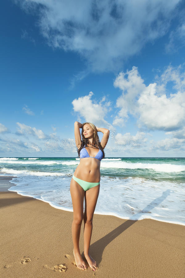 Download Young woman on the beach stock image. Image of water - 25555647