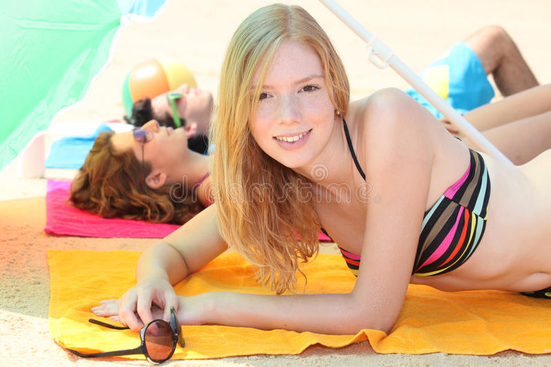 Download Young woman at the beach stock image. Image of lazy, suit - 25670567