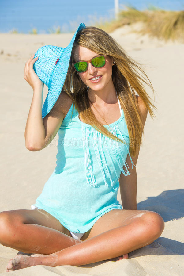 Young woman on the beach with pamela and blue shirt stock photos