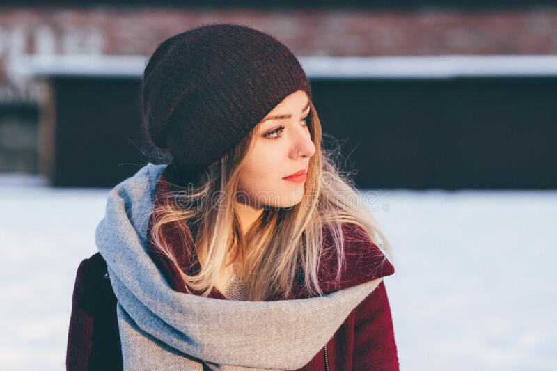 Young woman in beanie hat stock photos