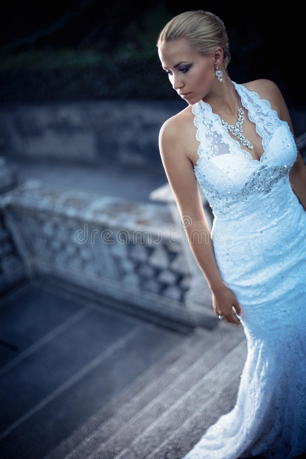 Young woman. Beautiful young bride in a white dress stock images
