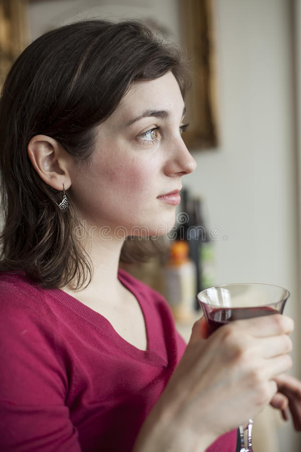 Young Woman with Beautiful Green Eyes Drinking Wine royalty free stock images