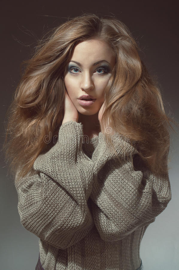 Young woman with beautiful long hair in knitted stock photo