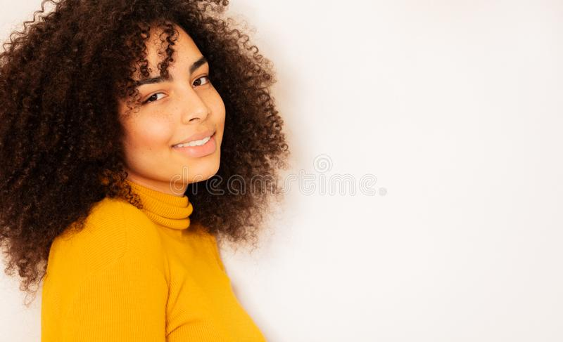 Young woman with beautiful smile and curly hair stock photos