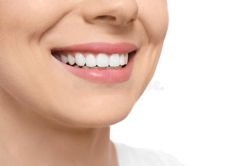 Young woman with beautiful smile on white background. Closeup. Teeth whitening royalty free stock photography