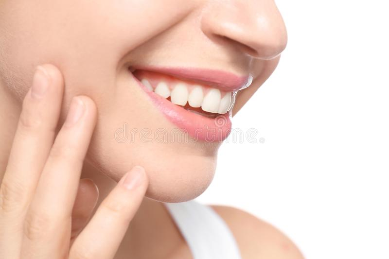 Young woman with beautiful smile on white background,. Closeup. Teeth whitening royalty free stock photo