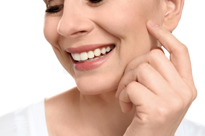 Young woman with beautiful smile on white background. Closeup. Teeth whitening stock photography