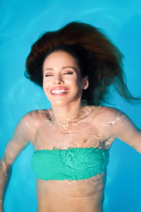 Young woman beauty portrait in water stock images