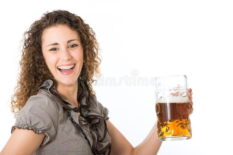 Young woman with beer. Mug royalty free stock photos