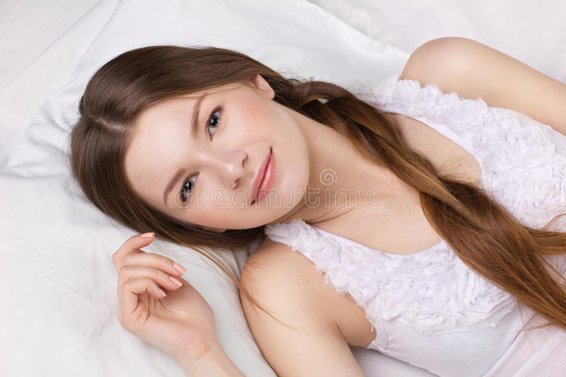 Young woman in a beg royalty free stock photos