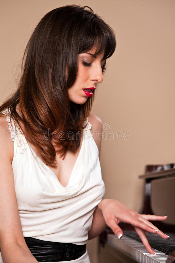 Young Woman behind the Piano