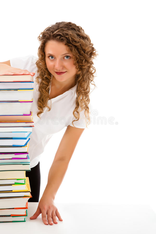 Download Young Woman Behind Pile Of Books Isolated On White Stock Photo - Image of person, 20: 31411942