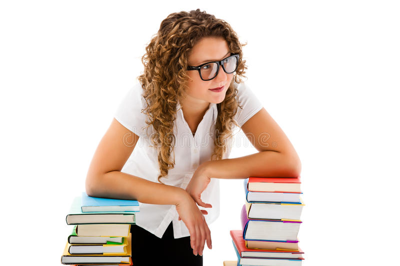 Download Young Woman Behind Pile Of Books Isolated On White Stock Photo - Image: 31411964